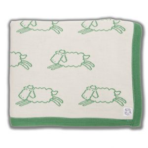 Cream blanket with green edging and green sheep pattern