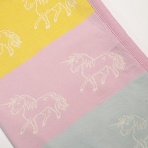 Pink, yellow & blue blanket with unicorn print