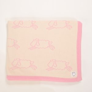 Cream blanket with pink edging and sheep pattern