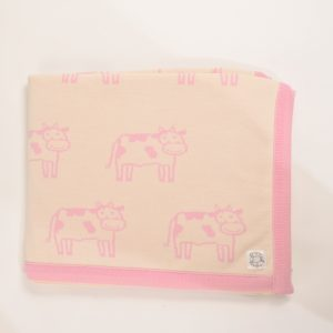 Cream blanket with pink edging and cow pattern