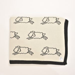 Cream blanket with black sheep pattern
