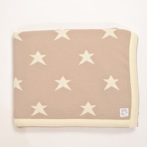 Latte coloured blanket with cream edging and stars