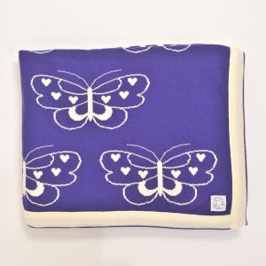 Purple blanket with cream edging and cream butterfly pattern
