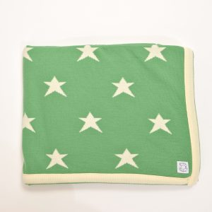 Green blanket with cream edging and stars