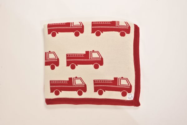 Cream blanket with red firetruck pattern