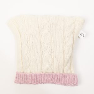 Cream cable knit beanie with pink edging