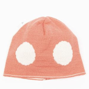 Salmon coloured beanie with cream spots