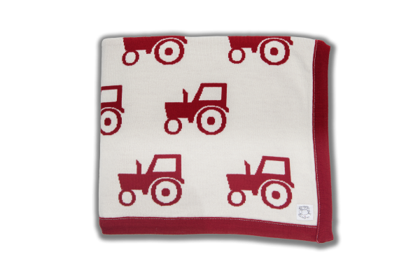 Cream blanket with red edging and red tractor print